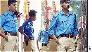 Policemen guard a Hindu temple in Dhaka