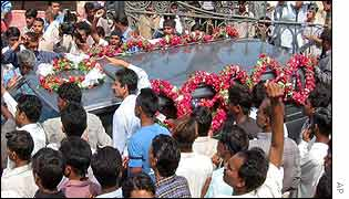 Mourners hold the coffin of one of Wednesday's victims