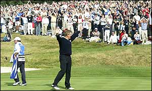 Colin Montgomerie raises his arms and acknowledges the crowd after sealing Europe's first win of the day, beating Scott Hoch 4&3 to put Europe 9-8 up