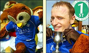 Chaddy the Owl, aka Kevin Williams, celebrates a sweet victory in the Mascot Grand National