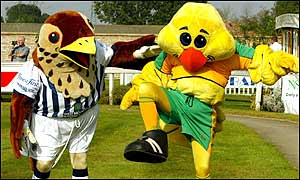West Brom's Baggie Bird and Norwich City's Captain Canary pose before the race