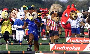Oldham Athletic's Chaddy the Owl begins to establish a lead over the other mascots