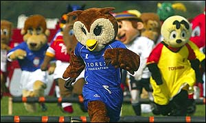 Oldham Athletic's Chaddy the Owl surges to victory in the race