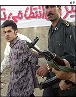 Amir Karbalai (l) being led to execution