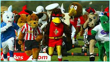 Football mascots from around the country take part in the race at Huntingdon Racecourse, Cambridgeshire