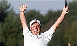 Paul McGinley raises his arms in triumph after winning the Ryder Cup