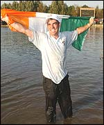 Europe's star man Paul McGinley soaks upo the celebrations