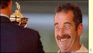 Sam Torrance's eyes bulge as he recieves the Ryder Cup