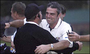 Europe vice-captain Ian Woosnam hugs Paul McGinley