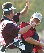 Paul Azinger celebrates his chip on the 18th