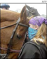 A protester bonds makes friends with a police horse