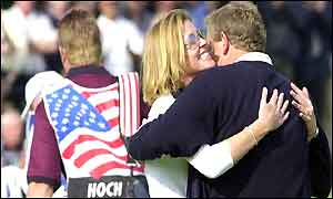 Colin Montgomerie hugs his wife Eimear after winning his singles match against USAs Scott Hoch
