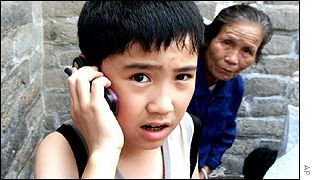 Chinese boy using mobile
