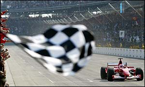 Rubens Barrichello takes the chequered flag at Indianapolis
