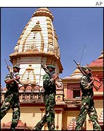 Indian soldiers patrol outside a temple in Bhopal