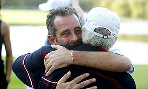 Sam Torrance embraces US captain Curtis Strange after seeing his Europe team win the Ryder Cup