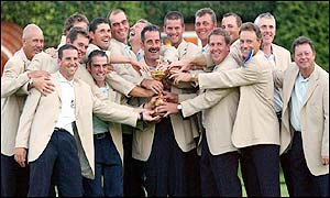 The European team regroup for a photo as they show off the Ryder Cuip trophy