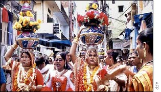 Indian eunuchs taking part in a procession in memory of their dead elders