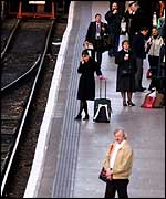 Commuters wait for delayed train