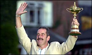 Sam Torrance holds the Ryder Cup aloft