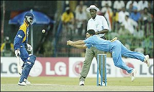 Tendulkar attempts a dramatic catch but drops the ball