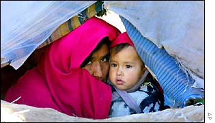 Afghan refugee mother and child in tent