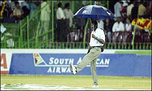 Heavy rain stops play for the second time and again the match is abandoned