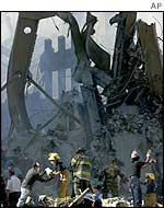 Firefighters search the rubble of the World Trade Center on 13 September 2001.