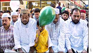 Muslim men pray during a march in New York