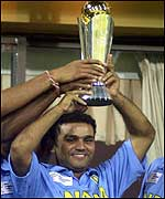 Virender Sehwag holds the trophy