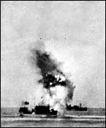 A merchant ship explodes during the Malta convoy