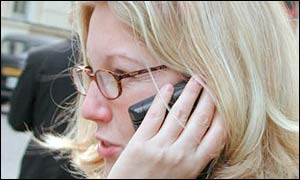 File photo of woman using a mobile phone