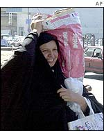 Woman with bag of food in Baghdad