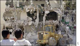 A Palestinian bulldozer works to clear rubble in Yasser Arafat's compound in Ramallah