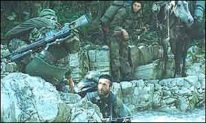 Chechen rebels cross stream, pictured by Roddy Scott