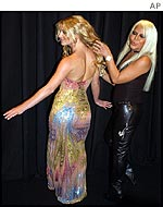 Donatella Versace attends to Britney Spears at the Versace spring/summer show in Milan