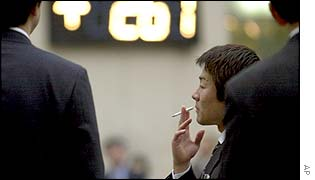 Japanese businessman smoking a cigarette