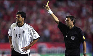Referee Urs Meier shows Michael Ballack a second yellow at the World Cup