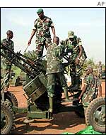 Rwandan forces dismantle an anti-aircraft gun