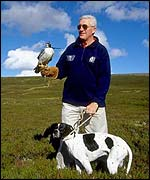 Scotland coach Jim Telfer with falcon and spaniel