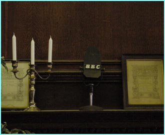 An old BBC microphone stands as an ornament on the mantelpiece