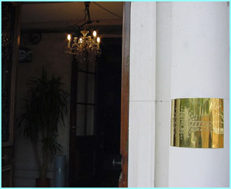 A simple plaque at the front door is all that marks the house as the Fame Academy