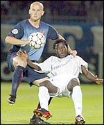 Benjani is challenged by Cygan
