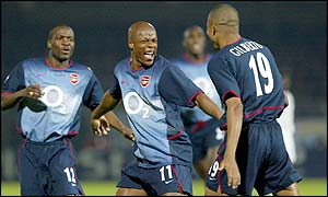 Sylvain Wiltord congratulates Gilberto Silva after his winning goal against Auxerre