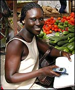 Senegalese woman with mobile phone