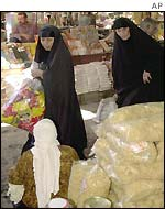 Iraqi women shop in a market in Baghdad