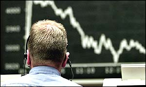 a stock market trader looking at a board showing a market that has fallen