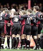 Southampton players go into their pre-match huddle