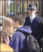 pupils leaving Stoke Newington School - Media Arts College with police present