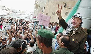 Yasser Arafat greets crowds outside his wrecked headquarters in Ramallah